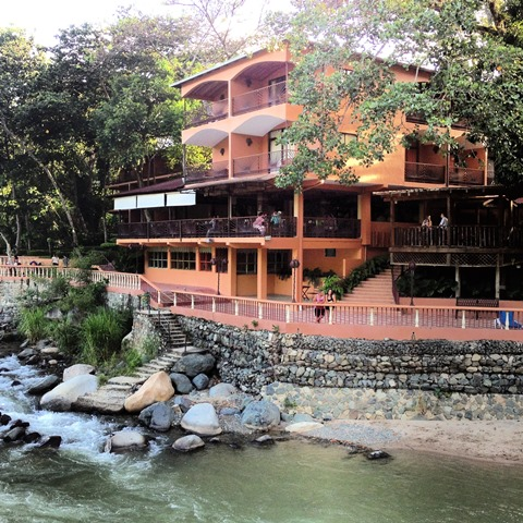 The restaurant and one of two buildings with prime rooms featuring river views.